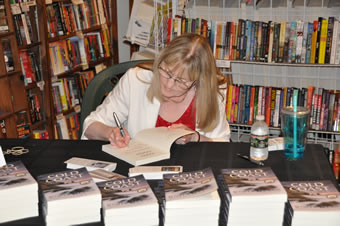 Author Jenifer LeClair signing books at the COLD COAST